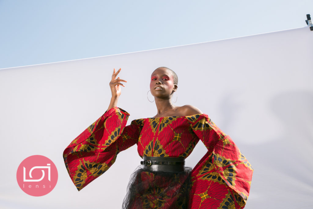 red makeup, Blackcreatives #ankara, ankara travelling dress, ukbft, travelling dress, travelling dress project, female photographer, fashion photography, black model, bald model, fashion photoshoot, african fashion, african print, travelling dress project, the travelling dress